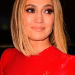 Jennifer Lopez with a solid long bob Lob haircut with straight center part hairstyle and golden balayage Bronde hair colour