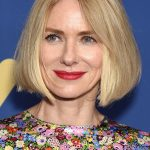 Naomi Watts bob haircut and blonde highlights with blonde hair colour with a straight center part hairstyle with volume