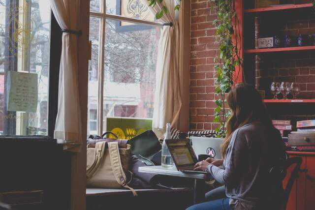Woman using the computer in a cafe.