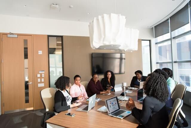 People holding a meeting in a conference room.