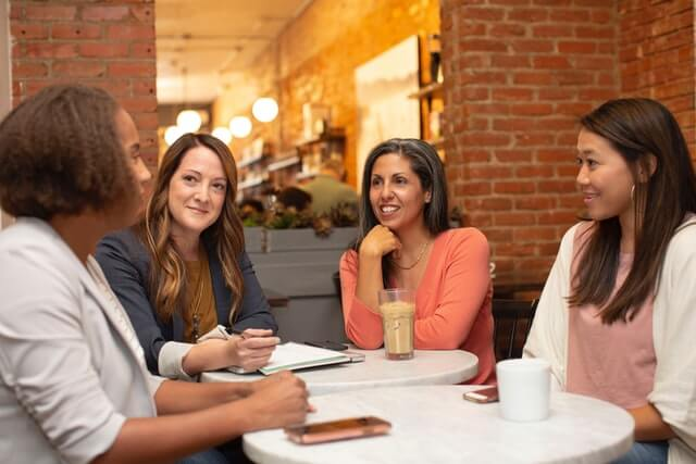 Women at a meeting in a coffee shop.