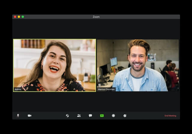 A man and a woman have an online video meeting.