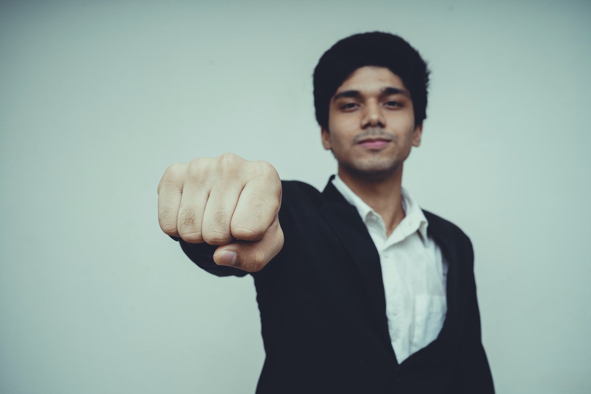 A man shows his fist to the camera.