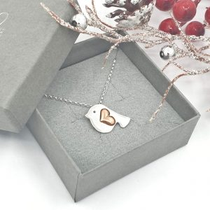 silver robin necklace with copper heart wing