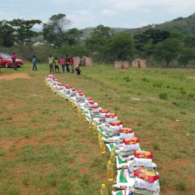 About 25 children at a time were called to fetch food. 10kg of flour, beans, sugar, tea and more
