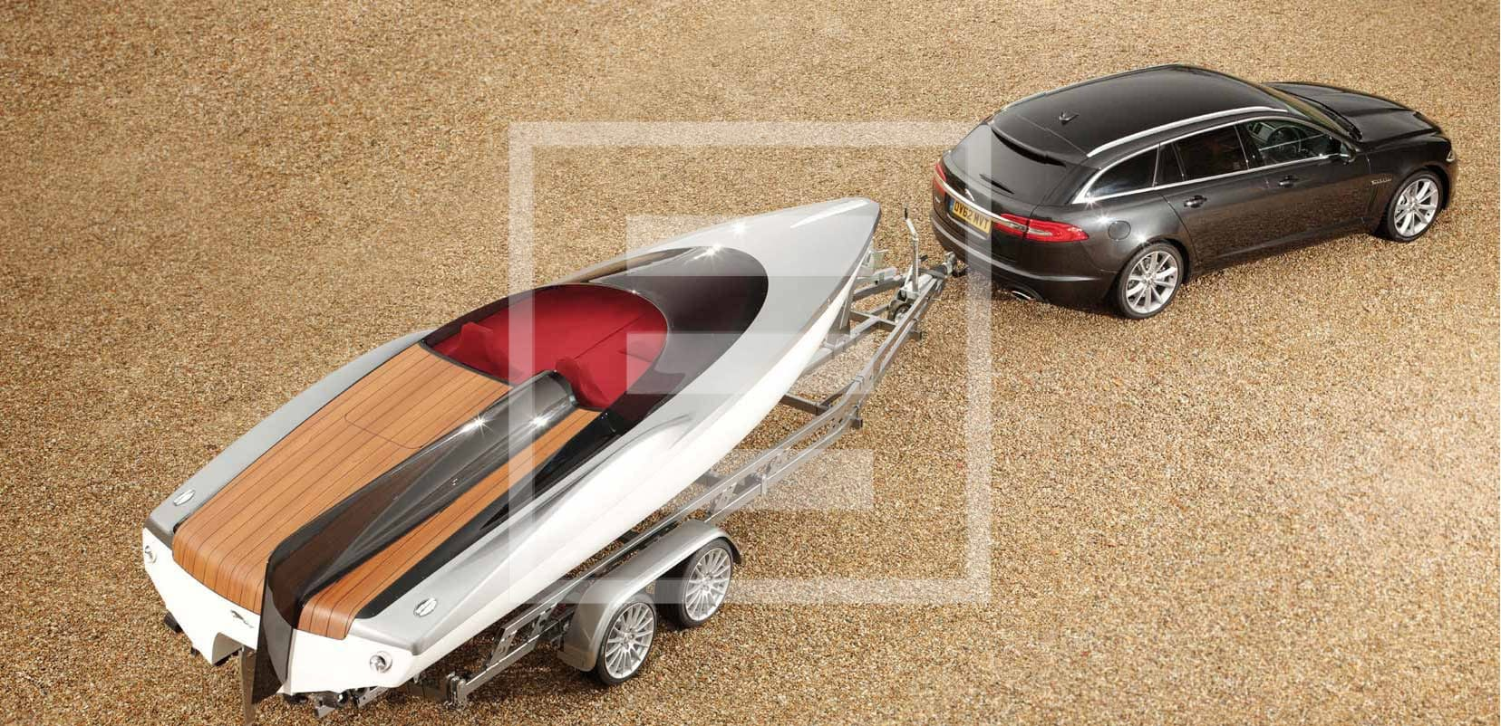 The Jaguar XF Sportbrake and the Concept Speedboat designed by Ian Callum for the launch of the iconic English marque's model. The Speedboat's vertical fin is inspired by the Jaguar E2A