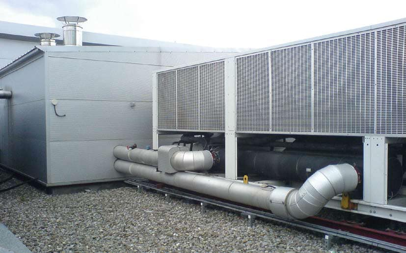 HOW COOL! – The figure shows the boiler (left) and the chiller (right) which supply hot and cold water to the Air Handling Unit to heat and cool the air.