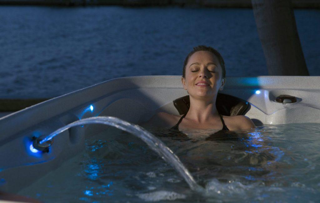 Woman soak away ailments with a hot tub
