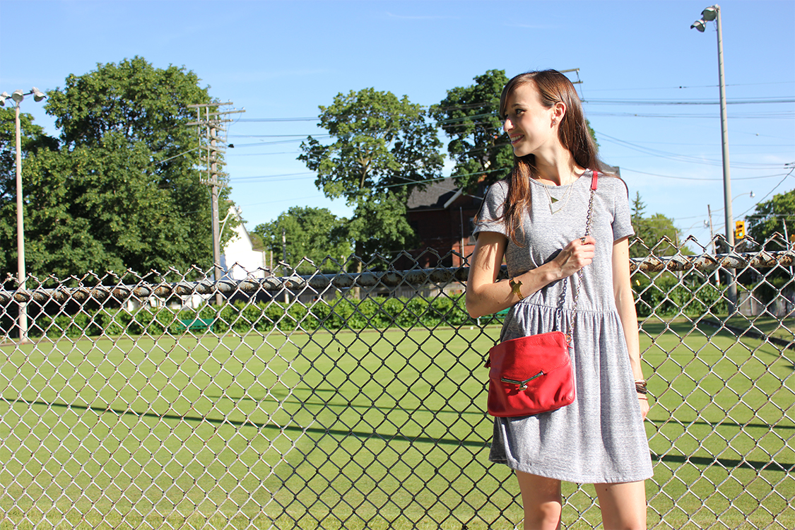 Style Bee in a grey dress, botkier bag.