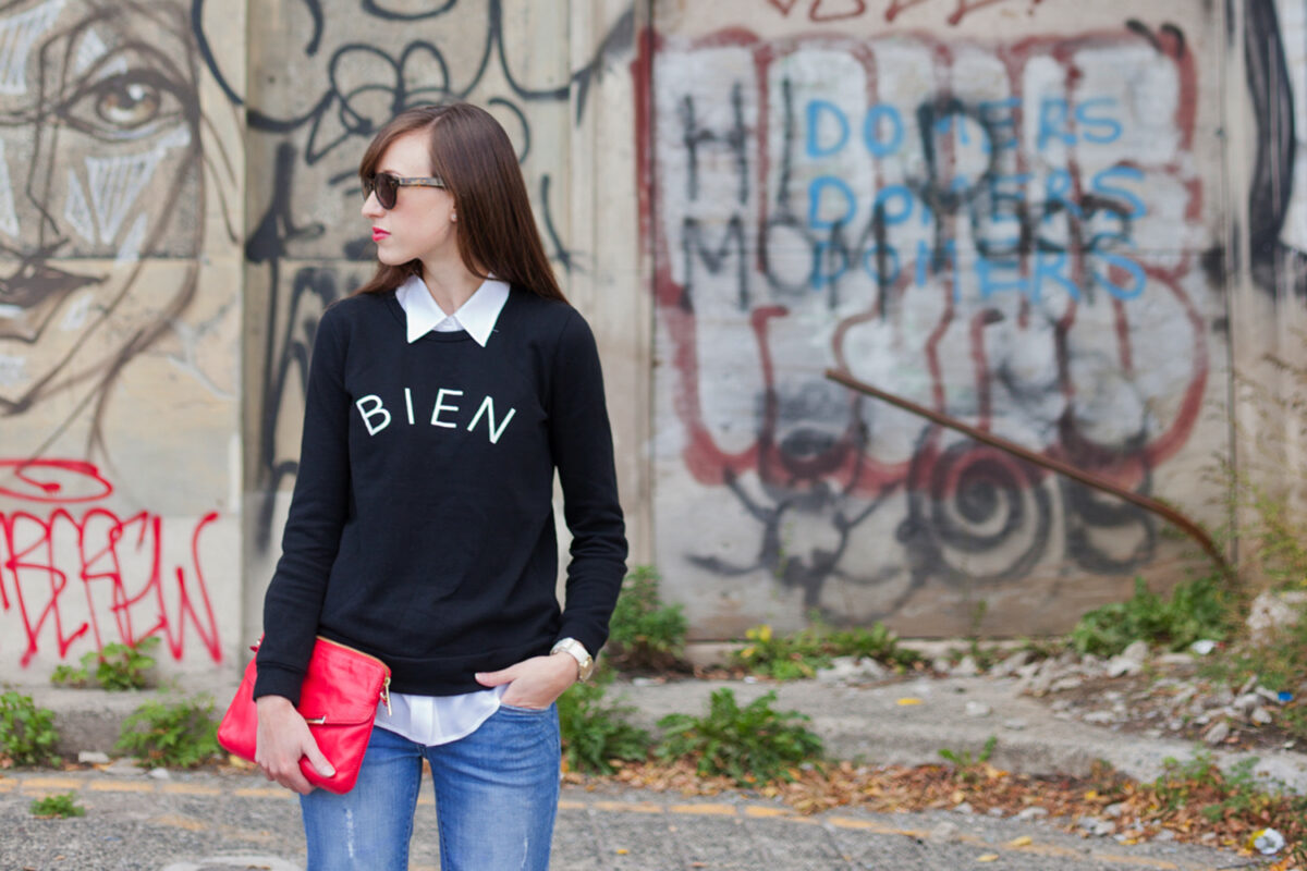 Style Bee in Bien Fait sweater, jeans and Botkier clutch.