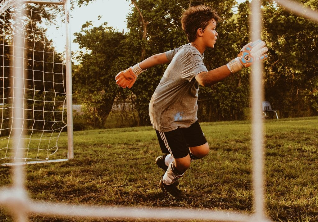 child-playing-football