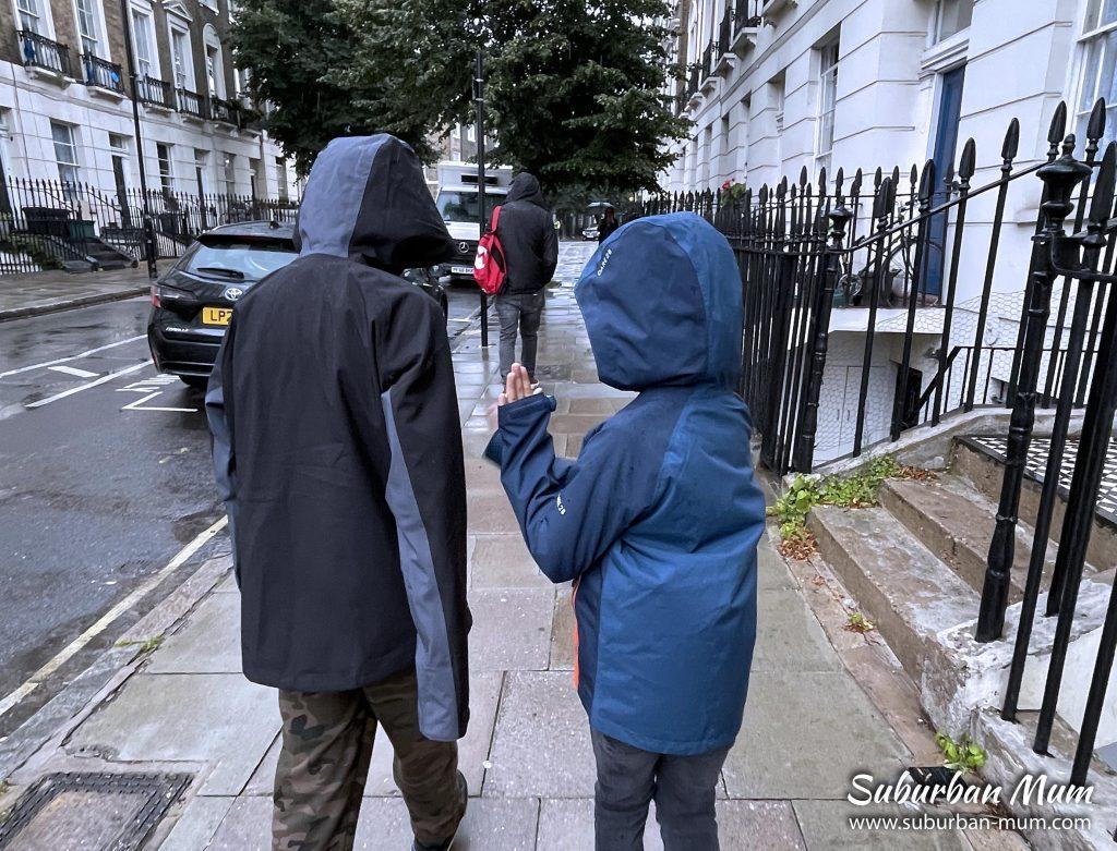 boys-walking-in-rain