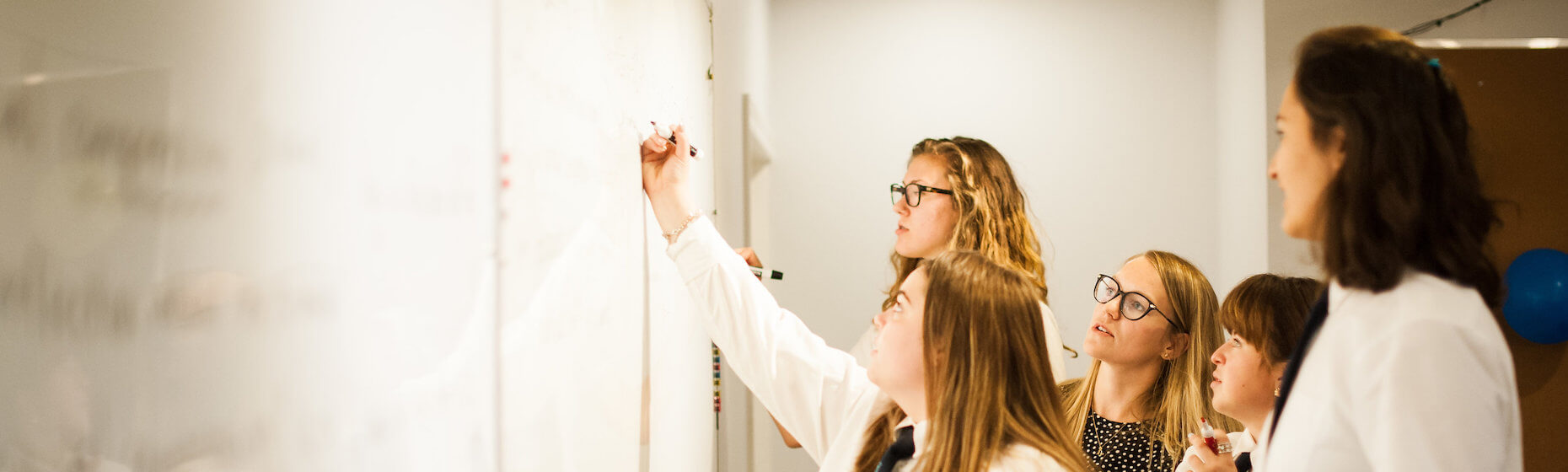Girls in Math Class for Upper School Banner