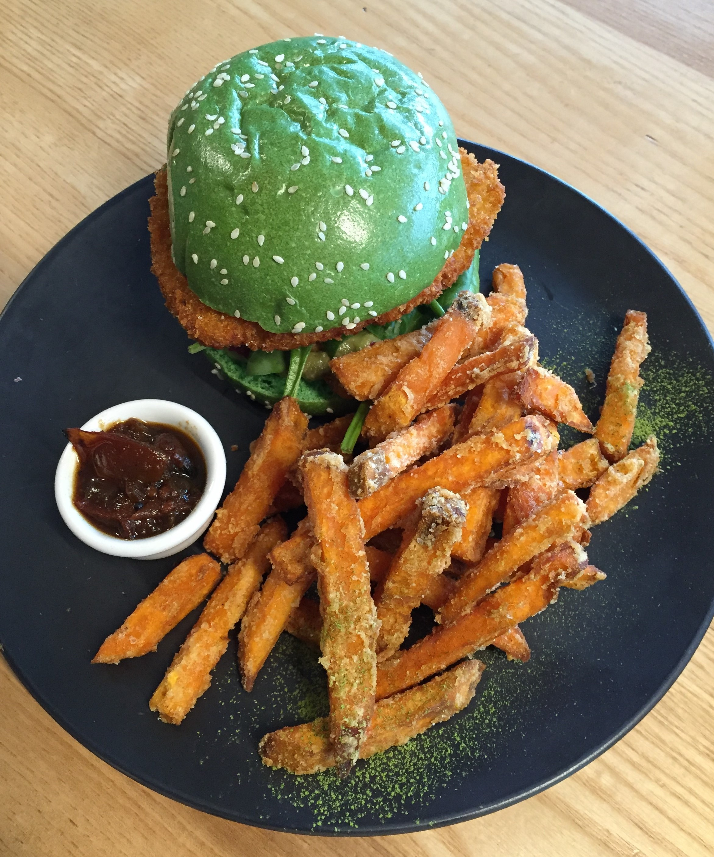 Green vegan burger and sweet potato fries at Matcha Mylkbar, Melbourne.