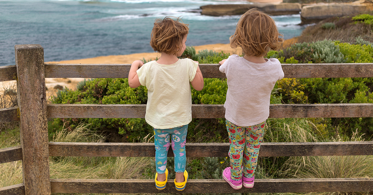 Kids looking at view, Great Ocean Road, Australia
