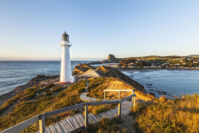 Castlepoint Lighthouse, Wairarapa, New Zealand, at sunrise.