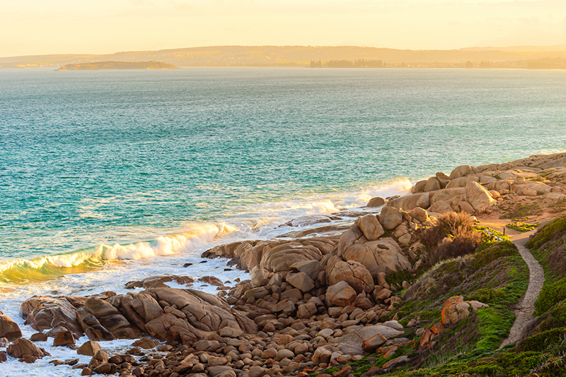 Rocky Bay with walking trail at sunset, Port Elliot