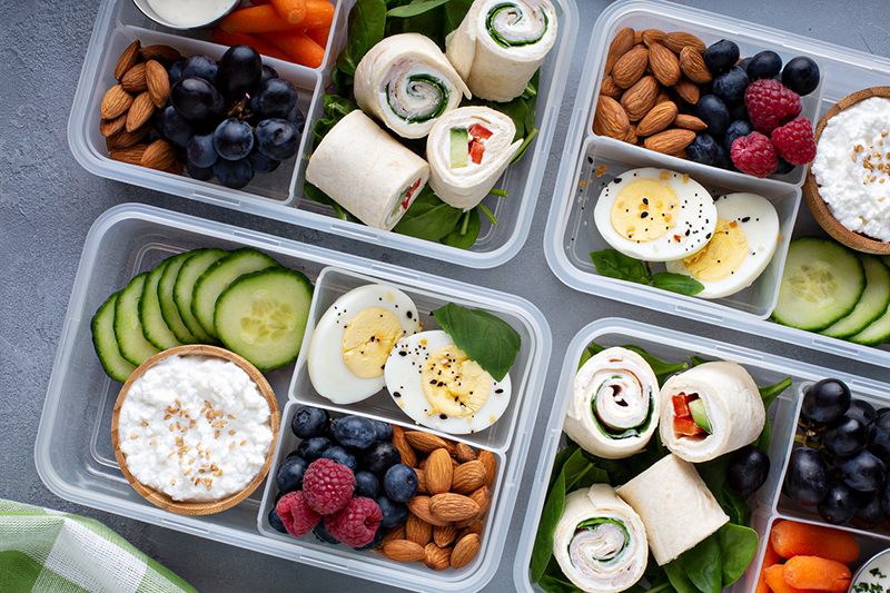 Healthy lunch or snack to go with tortilla wraps, eggs, cottage cheese, fruits and vegetables
