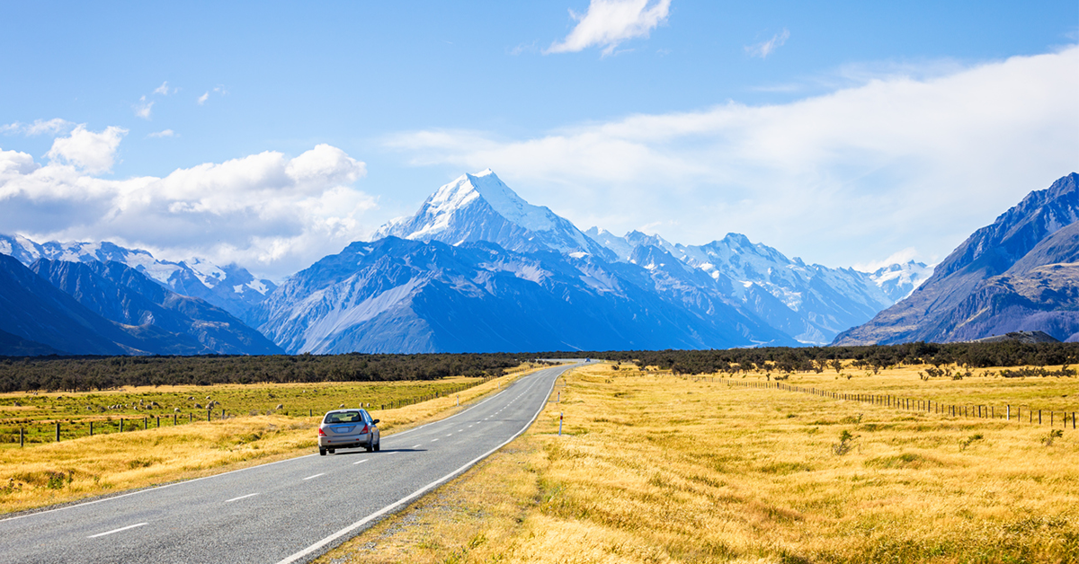 View of car, road leading to mount cook national park, South Island New Zealand