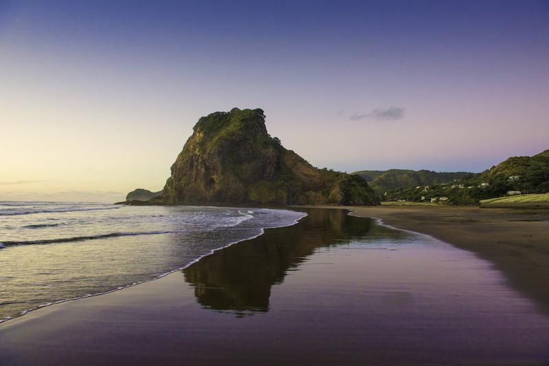 Lion Rock and Piha's famous black sand. Piha, New Zealand.