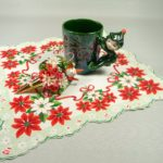 photo of vintage elf mug with matching hankie and tussie mussie pin