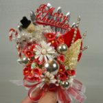 photo of vintage bottle brush and snowman corsage
