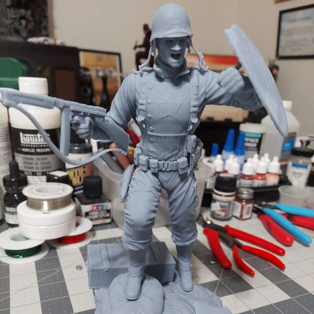 CAPTAIN AMERICA 1945 Super Soldier - CAPTAIN AMERICA 1945: Super Soldier  It is now possible to purchase the Super Soldier for 3D printing, another project tested and produced by DARK SKULL Collectibles in 1/6 scale. The test images were taken at scale 1/6 on an Anycubic Photon Mono X. Capitão America has:  2 Heads: Steve Head and Masked Head 2 Shields 1 Helmet 1 Removable Helmet 1 Removable Goggles With these additional pieces, various combinations will be possible. - The best files for 3D printing in the world. Stl models divided into parts to facilitate 3D printing. All kinds of characters, decoration, cosplay, prosthetics, pieces. Quality in 3D printing. Affordable 3D models. Low cost. Collective purchases of 3D files.