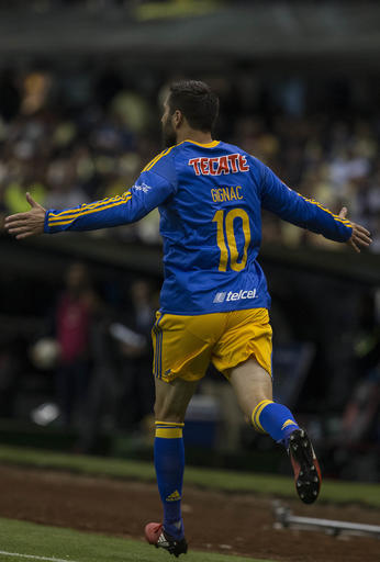 Tigres' Andre Gignac celebrates after scoring against America during the first leg of the Mexico league final, in Mexico City, Thursday, Dec. 22, 2016. (AP Photo/Christian Palma)