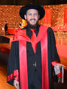 Photo of me in PhD gown