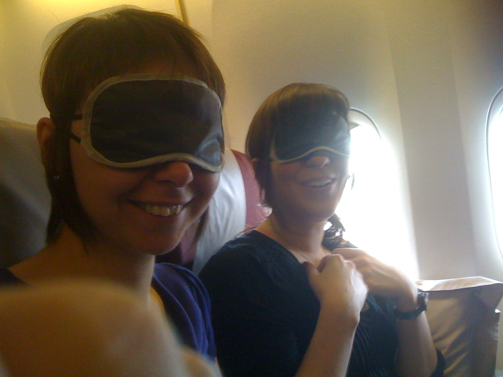The Jess Squared with sleepy-time masks on.