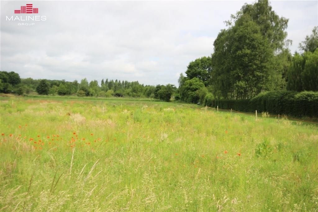 Goedgekeurde verkaveling bestaand uit 4 percelen met een uniek ver zicht over een uitgestrekt groen landschap.