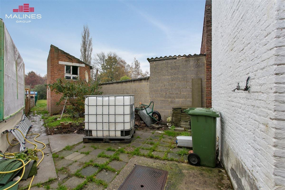 Te renoveren woning met tuin en 4 slaapkamers