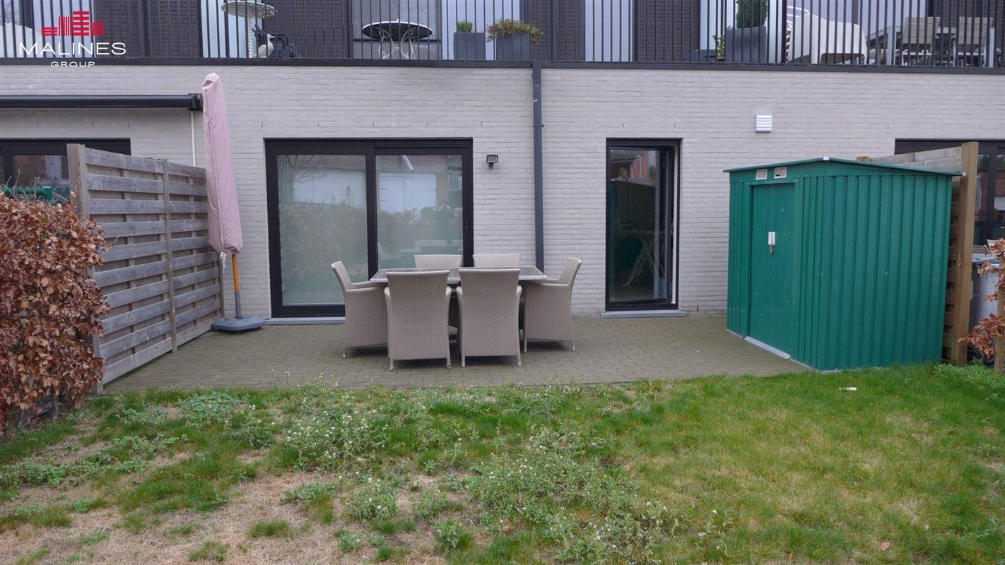 Gelijkvloersappartement met 2 slaapkamers en terras en tuin