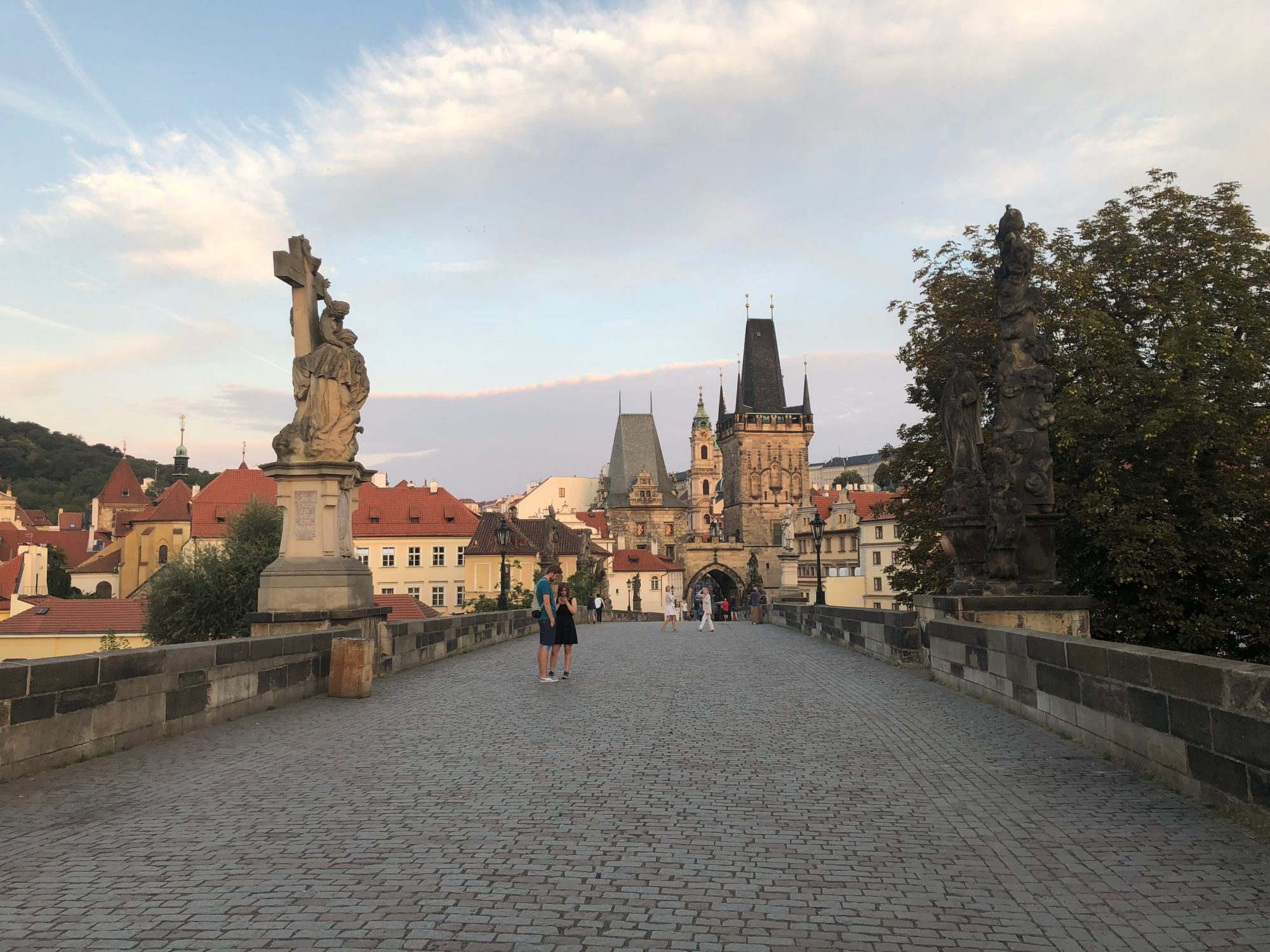 Early morning walk on the Charles Bridge in Prague from the Little Quarter