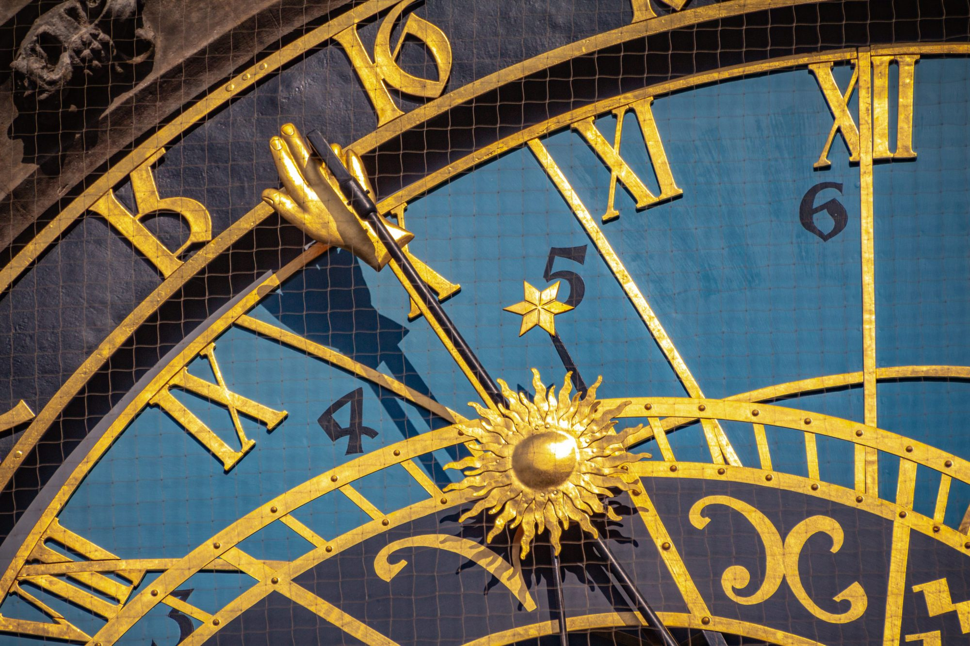 Astronomical Clock, detail  of the golden hand and numbers