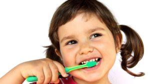 young-girl-brushing-her-teeth-1050x700