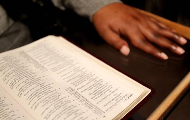 102311snHandDetail - State Passes Law Letting Teachers Use Bibles In The Classroom. Do They Have Your Support?