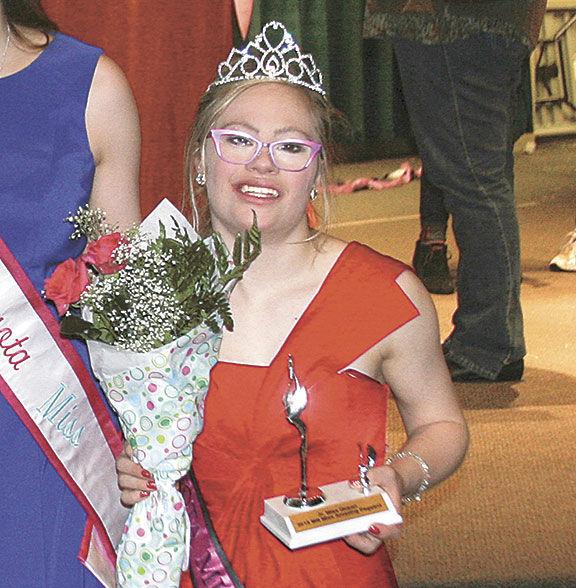 mh4 - Cette étudiante trisomique est candidate à une élection de miss: elle remet en cause tous les standards de la beauté