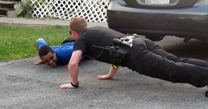 166f38bf41e60b0467774f129ec2267c 300x158 - Cop Suddenly Gets Down On The Ground And Start Push-Ups. Then, Boy's Reaction Is Priceless