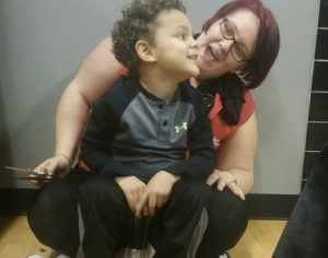 godupdates hairdresser sat on the floor boy with autism haircut 2 300x236 - Boy Panics And Screams At The Barber's. Mom Is Speechless When Stylist Gets Hair Done