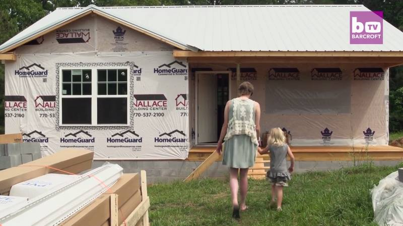 Courtney, Caroline and their beautiful new home. Image via YouTube.