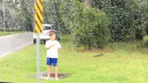 kaiden rain through window 600x337 300x169 - Boy Stands In Pouring Rain, Barefoot. Truth Behind Is Finally Revealed From A Photo