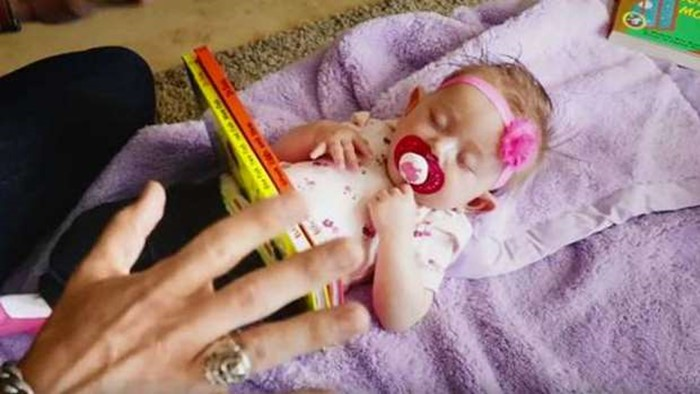 2 60 - Man Cuts Baby Daughter in Half with Magic Trick (video)