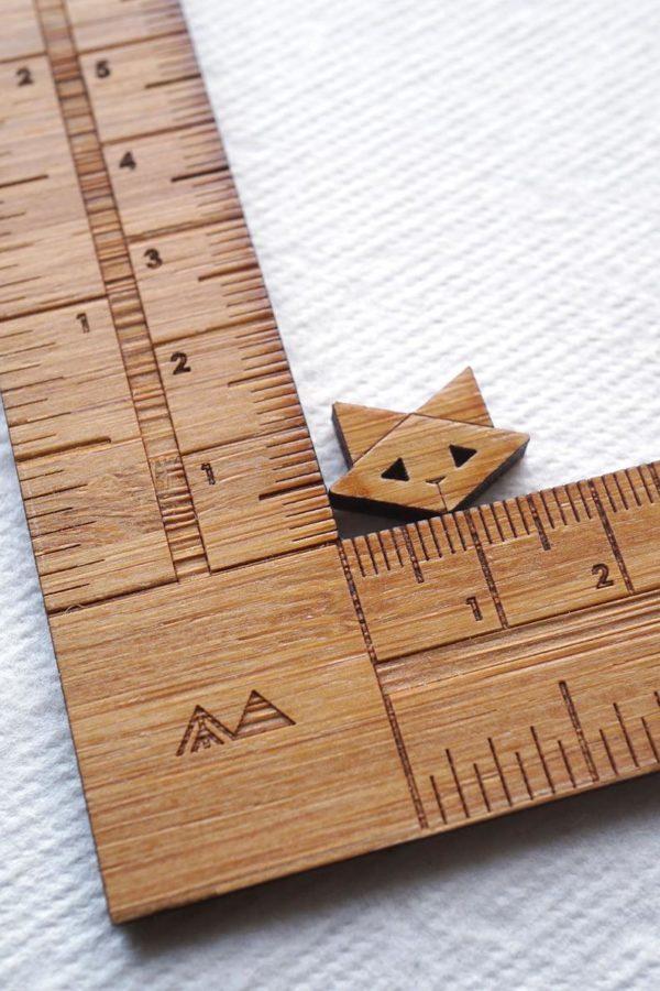 arrow mountain cat button