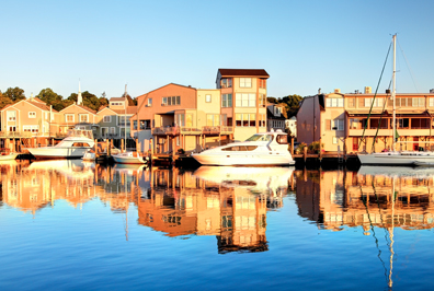 boats docked along the water in Mystic, Connecticut