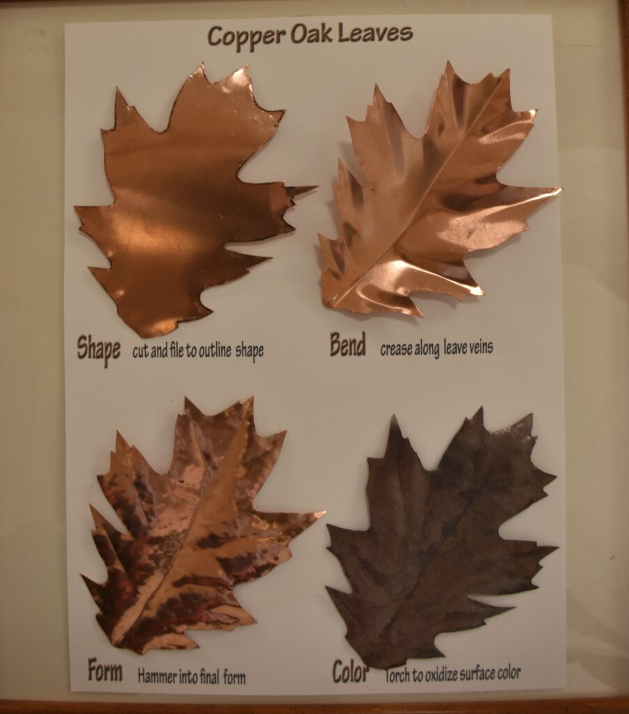 Last year I made a sculpture of different species of leaves copied from live samples of leaves here at Stoneridge. I decided to use a tracing of one of the oak leaves to create a single copper leaf mounted in a small oak frame for each of our combined siblings and children.   The four leaves displayed here show the main steps in the leaves' creation.