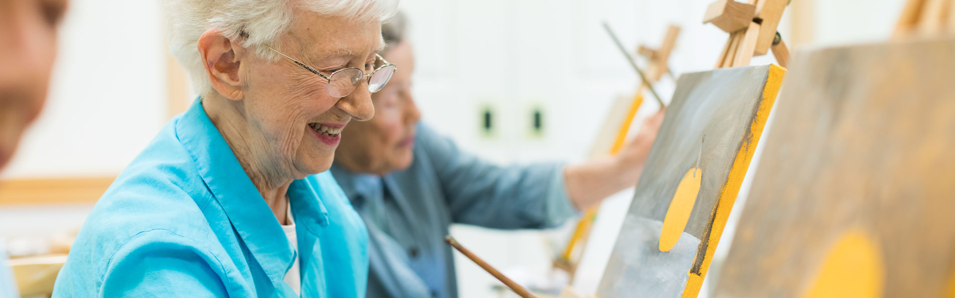 Senior woman painting at StoneRidge Independent Living