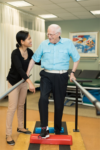 Physical therapy with senior man at StoneRidge Senior Living