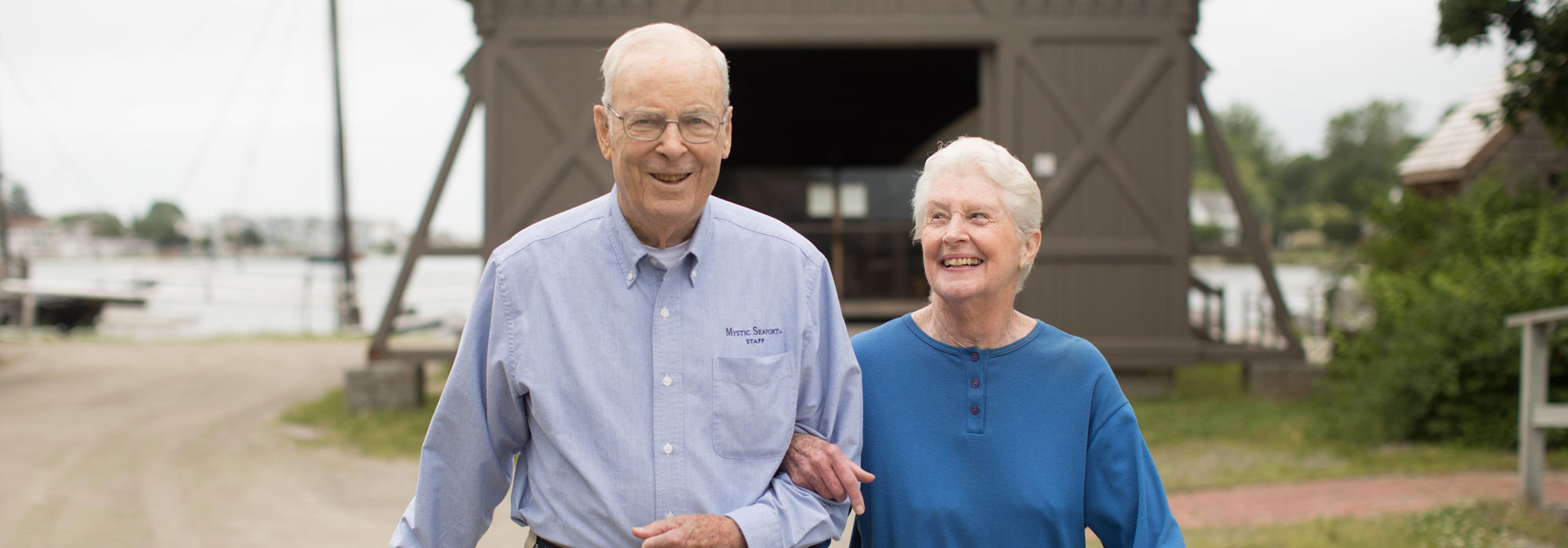 Senior couple walking outside at StoneRidge Senior Independent Living