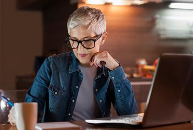Senior woman using her laptop